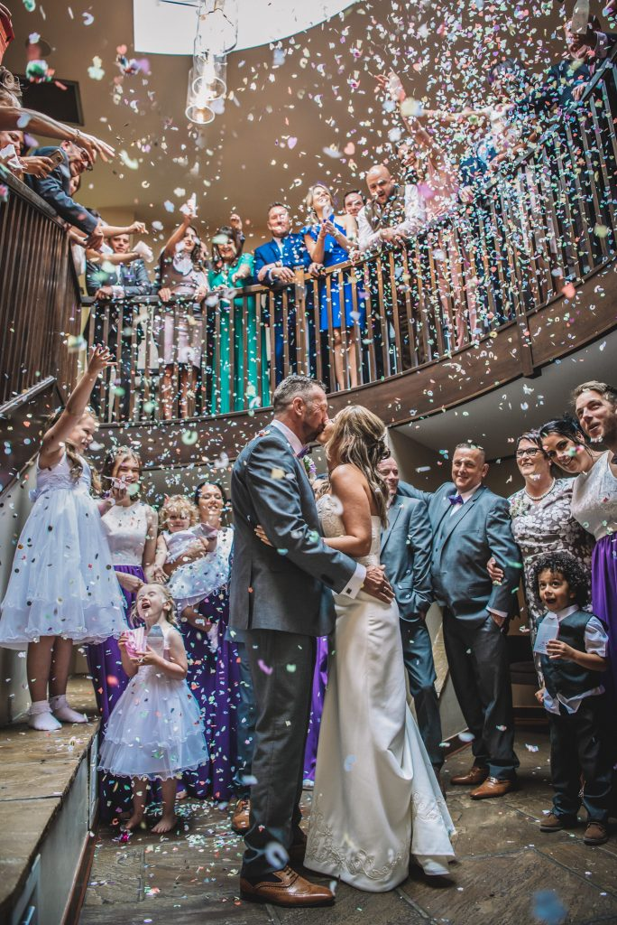 bride and groom confetti group on stairs at barton grange hotel