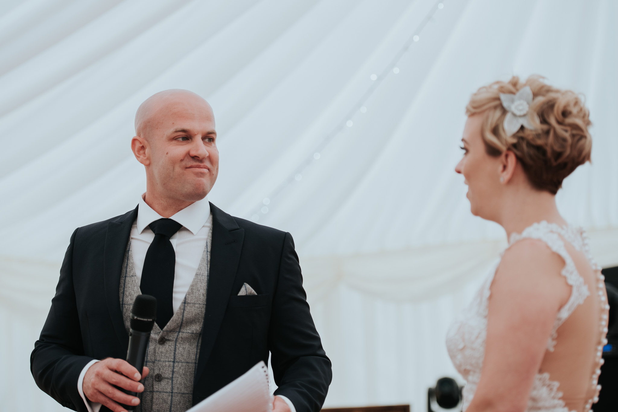 groom looking at bride during speech