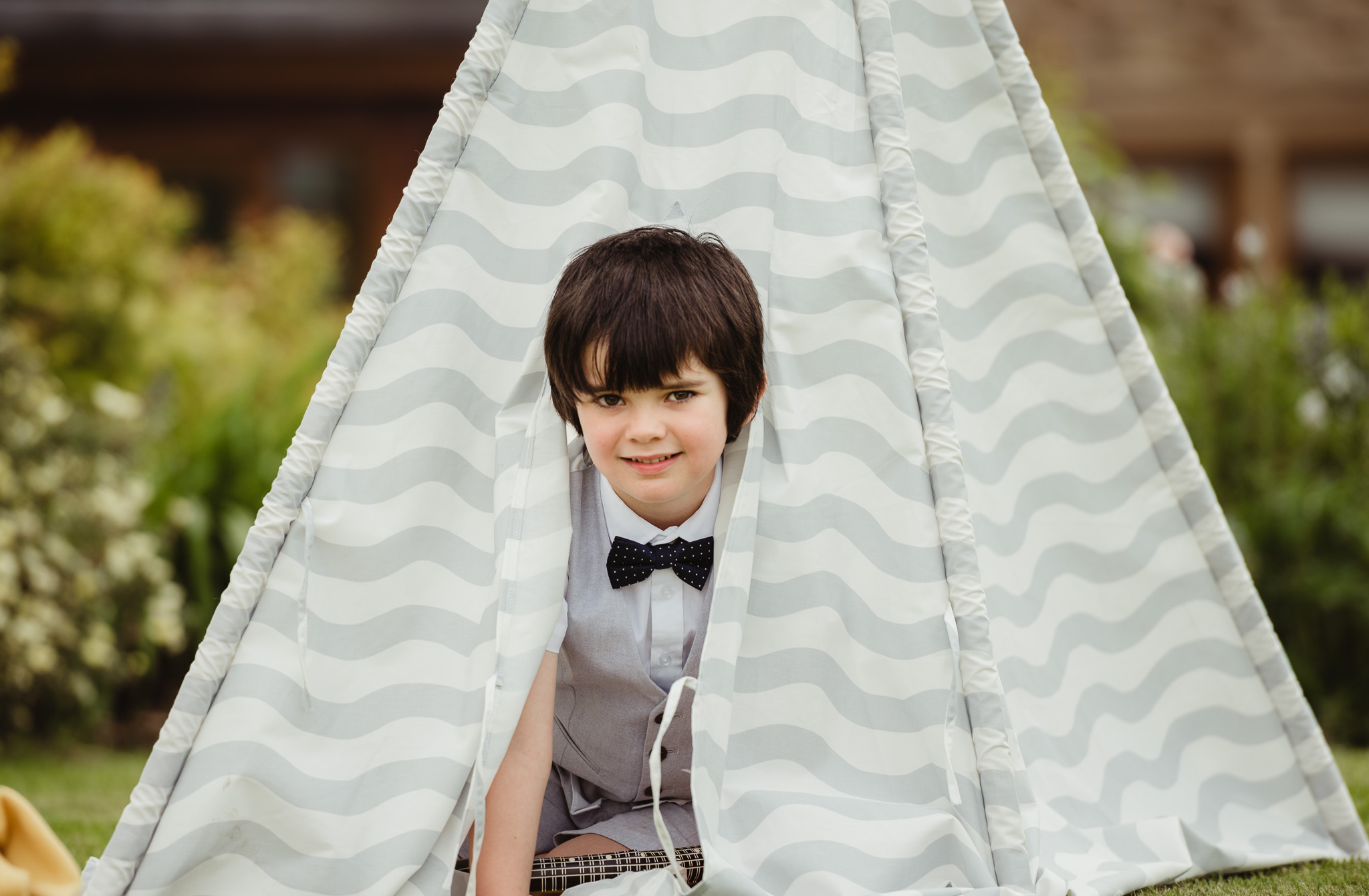 boy smiling in tipi