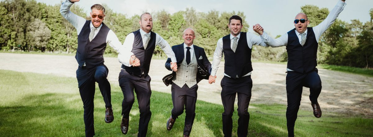 groomsmen having a laugh with photographer