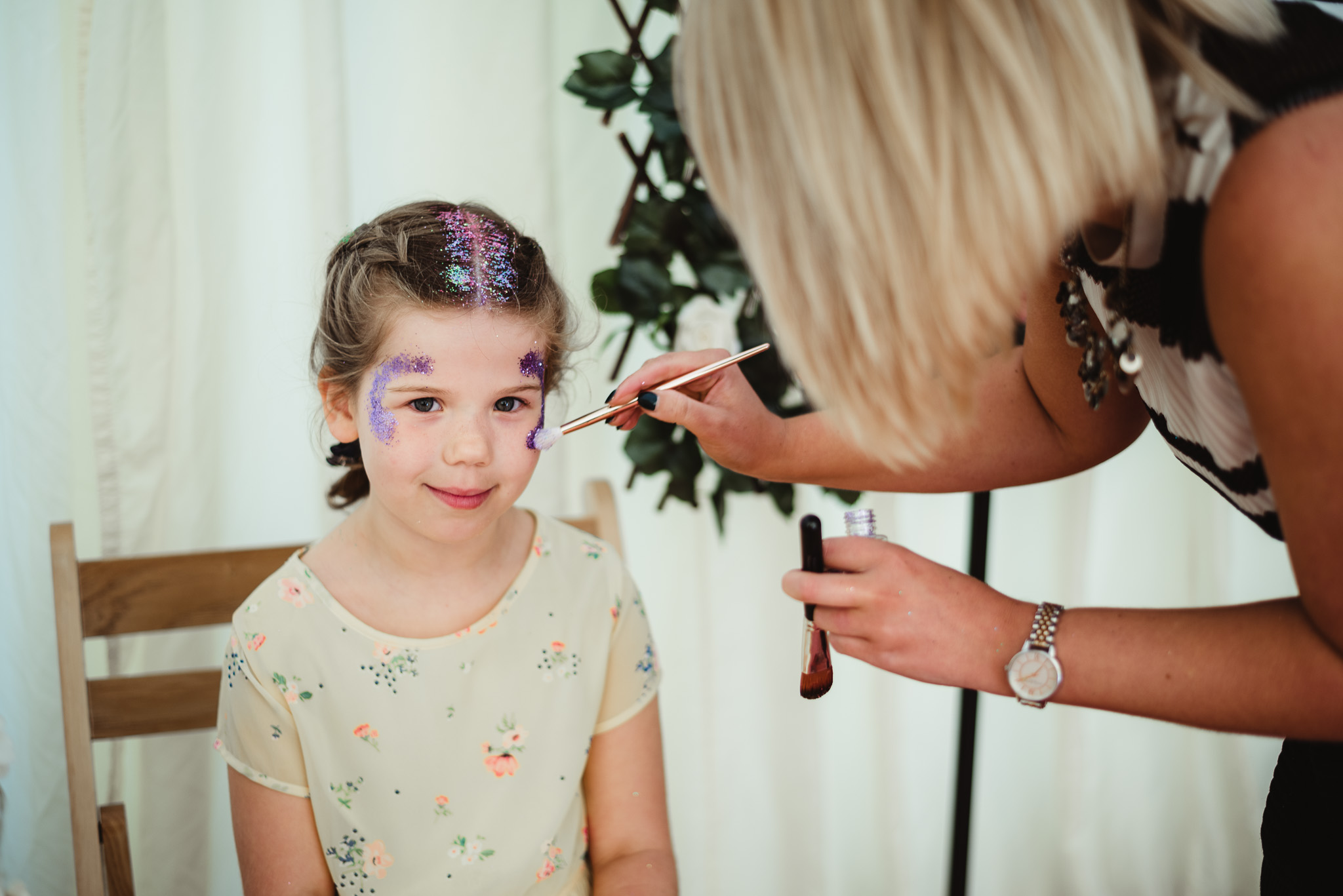 little girl at glitter bar